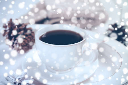 Beautiful winter composition with cup of hot drink. Snow effect Stock Photo