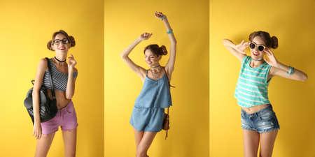 Hermosa chica de moda sobre fondo amarillo Foto de archivo