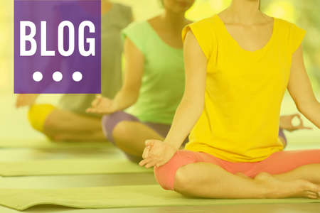 Young women meditating in yoga pose. Blog concept