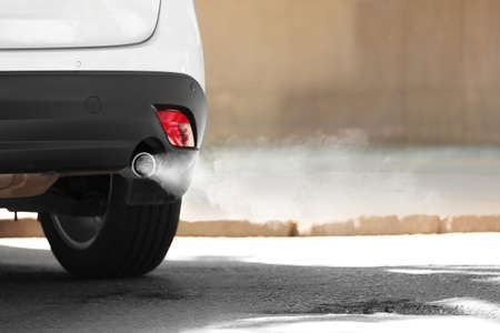 Exhaust pipe with smoke emission. Air pollution concept. 스톡 콘텐츠
