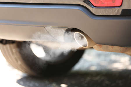 Exhaust pipe with smoke emission. Air pollution concept.
