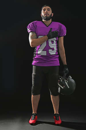 American football player on black background