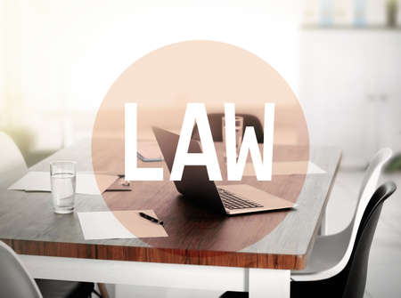 trial indoor: Law concept. Workplace with laptop and text design. Word law on conference office background.