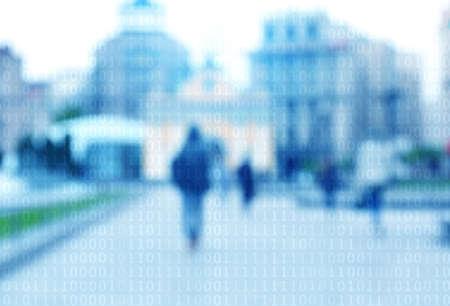 Binary code on blurred city street background. Stock Photo