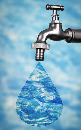 Conservation water concept. Metal faucet with drop on blurred water background. Stock Photo