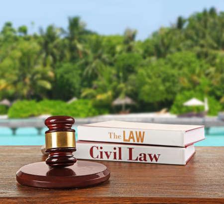 Judge hammer on resort background