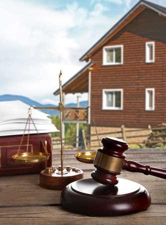 subprime mortgage crisis: Gavel on wooden house background Stock Photo