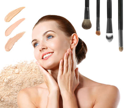 Beautiful young woman with makeup products samples and brushes on white background. Beauty treatment concept Stock Photo