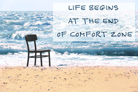 Comfort zone concept. Black chair on the beach Stock Photo