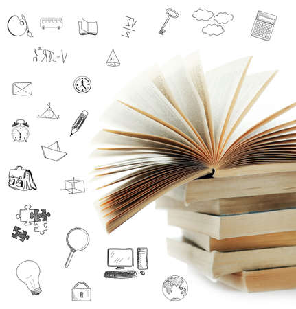 Stack of books with icons on white background. Stock Photo