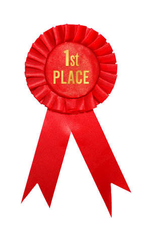 First place red ribbon award on white background. Stock Photo