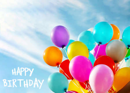 Happy Birthday text and colorful balloons on blue sky background Reklamní fotografie