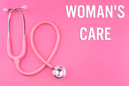 Gynecology concept. Pink stethoscope on pink background Stock Photo