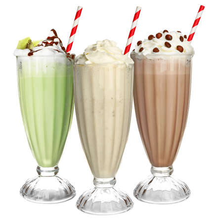 Glasses with delicious milk shakes on white background. Stok Fotoğraf
