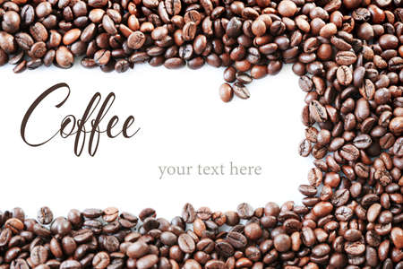 Roasted coffee beans with word COFFEE on white background. Space for text. Imagens