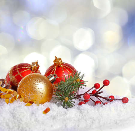 plaything: Christmas decoration on snow against bright blurred background.