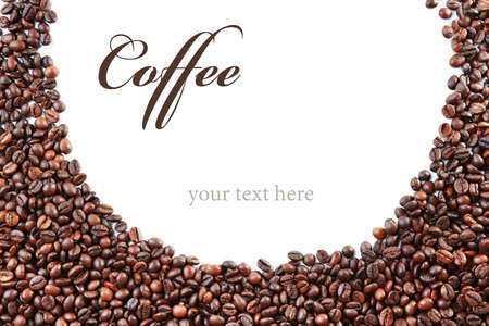 Roasted coffee beans with word COFFEE on white background. Space for text. Stock Photo