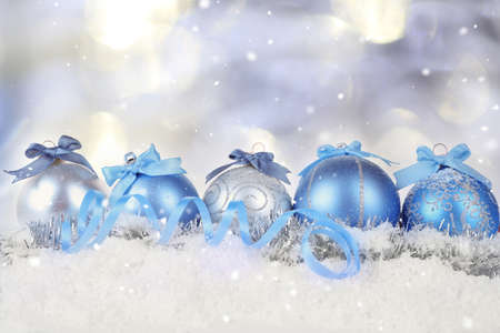 snowdrifts: Christmas decoration on snow against bright blurred background.