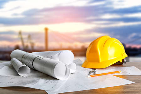 Construction blueprints with tools and helmet on sky background Фото со стока - 83212778