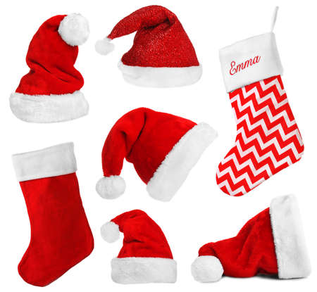 Santa Claus hats and Christmas stocking isolated on white Stock Photo