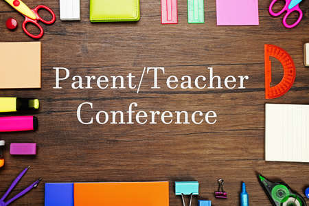 Text PARENTTEACHER CONFERENCE  with stationary on  wooden background. School concept. Stok Fotoğraf