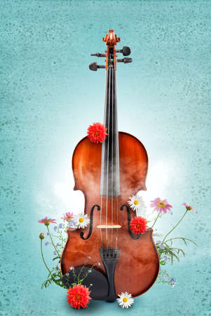 Classical violin with flowers on color background. Creative art work concept. Stock Photo