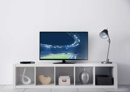 Watching football game on television at home. Leisure and entertainment concept.