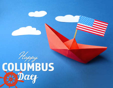 discoverer: Text HAPPY COLUMBUS DAY with paper boat and USA flag on blue background. National holiday concept. Foto de archivo