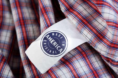 衣服ラベル テキスト製のアメリカ オリジナル、クローズ アップ。製造品質の概念。 写真素材