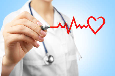 Cardiologist drawing heart, closeup. Cardiology concept.