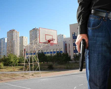 Man with gun on school playground