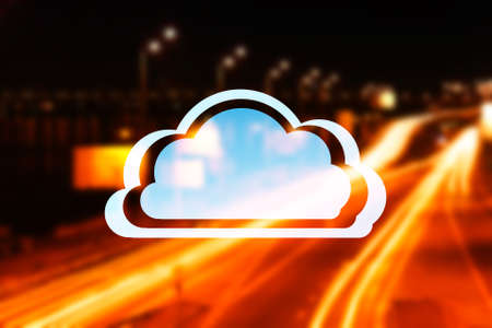 Cloud icon on blurred road traffic lights background. Modern technology concept