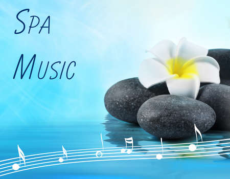 Spa music concept. Stones and flower in water