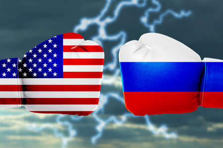 Governments conflict concept. Boxing gloves colored in USA and Russian flags on sky background