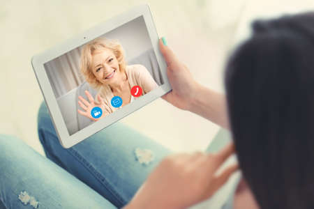Video call and chat concept. Woman video conferencing on tablet Standard-Bild