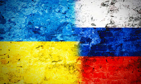 Governments conflict concept. Damaged wall colored in Ukrainian and Russian flags