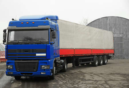 Truck near warehouse. Delivery and shipping concept. 版權商用圖片