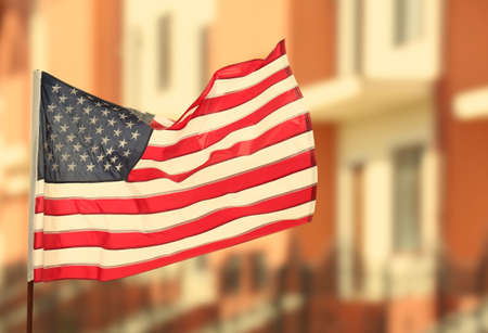 American flag on blurred building background Stock Photo
