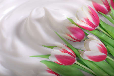 Natural treatments concept. Flowers on cream background