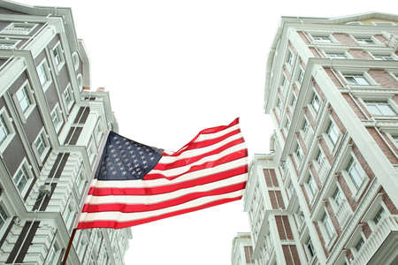 American flag on buildings background