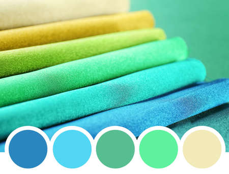 Palette with green color and textiles, closeup Stock Photo