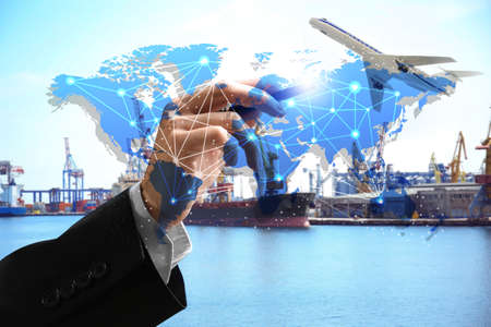Logistic concept. Man working with virtual screen and seaport on background