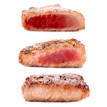 Different degrees of meat doneness on white background