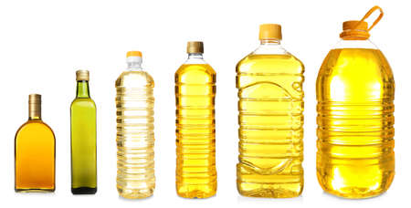 Different bottles with cooking oil on white background