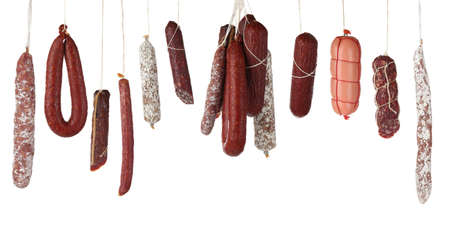 Different sausages on white background