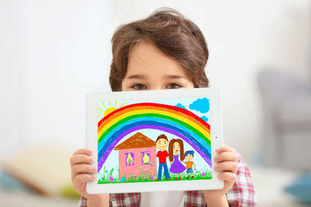 Little boy showing his drawing on tablet at home Imagens - 90827870