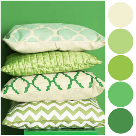 Color palette and soft pillows on green background