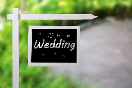 Signboard with word WEDDING outdoors