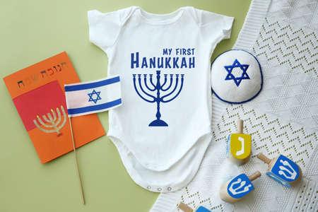Festive set for babys first Hanukkah on color background