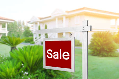 Signboard with word SALE in front of house Stock Photo